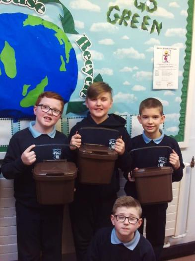 The Eco-Committee showing off our new brown caddies.